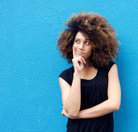 afro hair: Portrait of young african american woman with afro thinking