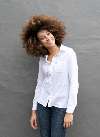people laughing: Portrait of a smiling young woman with afro hairstyle Stock Photo
