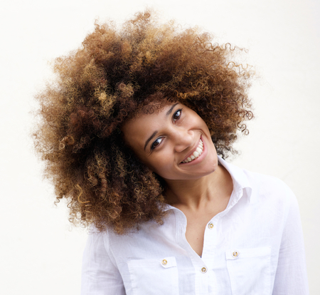 Portrait of a smiling young african american woman with curly hair Stock Photo