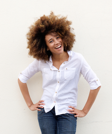 afro hair: Portrait of a young woman laughing with white shirt ad afro hair Stock Photo