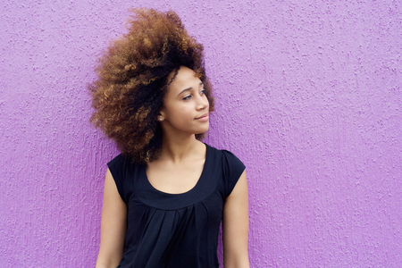 black woman face: Portrait of young african woman thinking and looking away