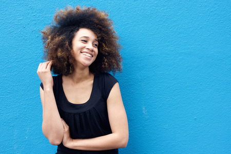 happy woman: Portrait of smiling african woman with afro hairstyle