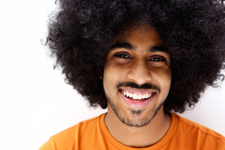 men face: Close up portrait of a smiling afro man with beard Stock Photo