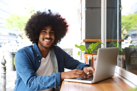 cool guy: Portrait of a cool guy working with laptop Stock Photo