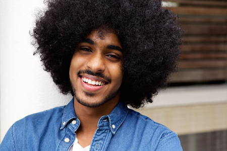 beard man: Close up portrait of a cheerful black man with afro