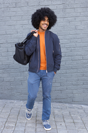 cool guy: Full length cool guy walking with bag