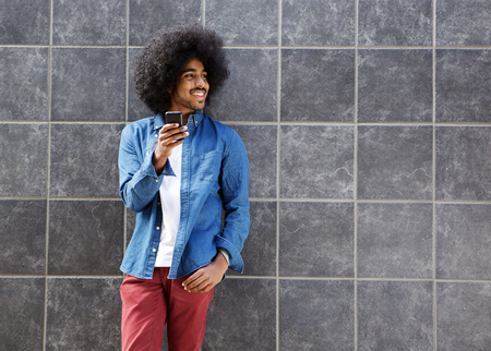 cool guy: Portrait of a cool guy with afro using cellphone