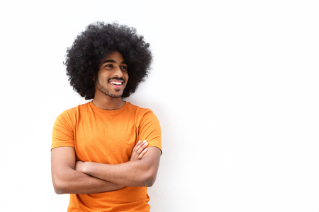 cool guy: Portrait of a cool black guy smiling with arms crossed against white background