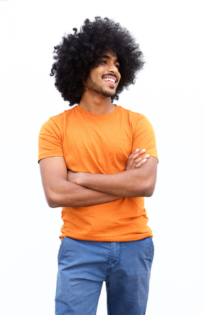 casual fashion: Portrait of a smiling black guy with arms crossed isolated on white background