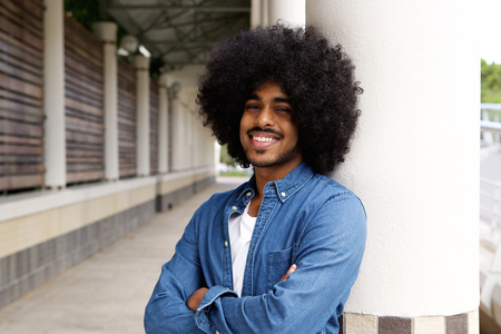 black guy: Portrait of a smiling black man with afro Stock Photo