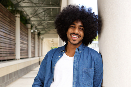 cool guy: Portrait of a cool black guy with afro smiling Stock Photo