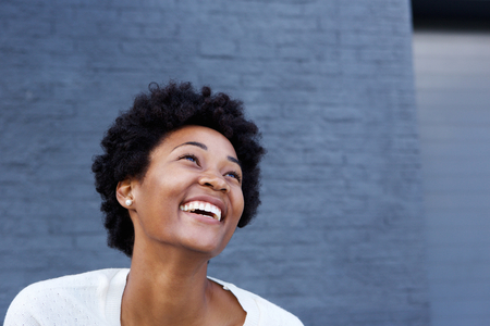 away: Portrait of smiling young african woman looking away at copy space