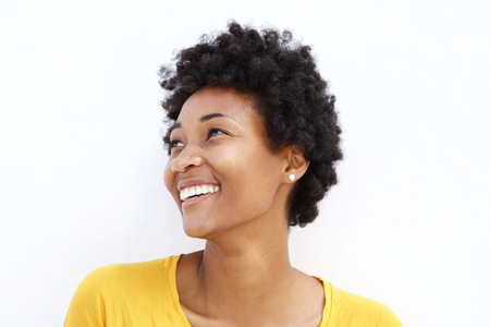 beautiful woman portrait: Closeup portrait of happy young african woman looking away against white background