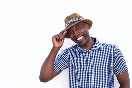 Close up portrait of a cheerful african american man with hat one white background Stock Photo