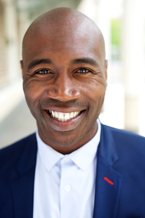 black male: Close up portrait of a smiling older african american businessman