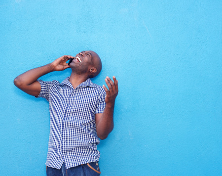 cheerful: Portrait of cheerful african man talking on mobile phone