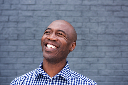 middle aged man: Close up portrait of african american man laughing