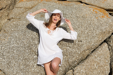 white woman: Portrait of a female fashion model in summer dress and hat Stock Photo