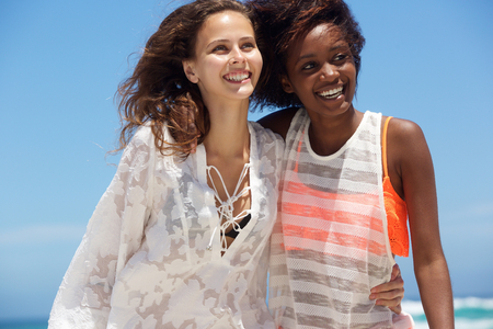 summer dress: Close up portrait of smiling young women at the beach Stock Photo