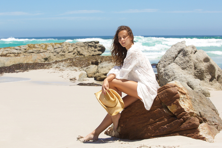 barefoot cowboy: Fashion portrait of a young woman in summer dress at the beach