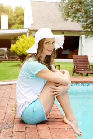 Portrait of an older woman smiling by poolside Stock Photo