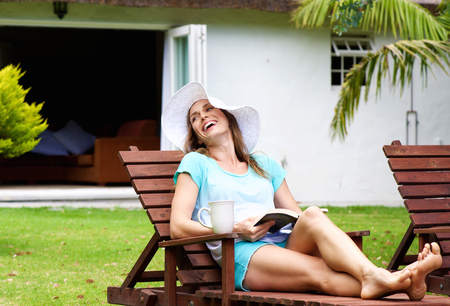 Portrait of a woman relaxing outside enjoying a book Stock Photo