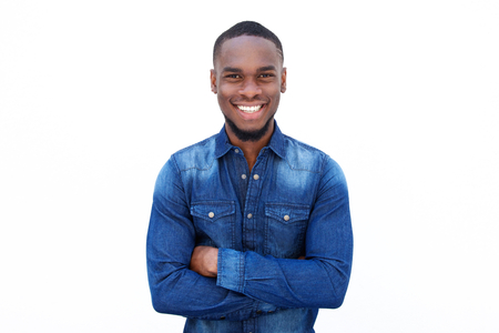 Portrait of a confident young african guy smiling with arms crossed against white background Standard-Bild