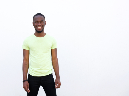 cool guy: Portrait of a cool young african american guy standing against white background