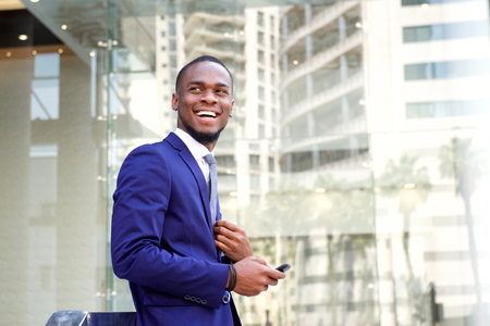 male fashion model: Portrait of happy young african american businessman with mobile phone Stock Photo
