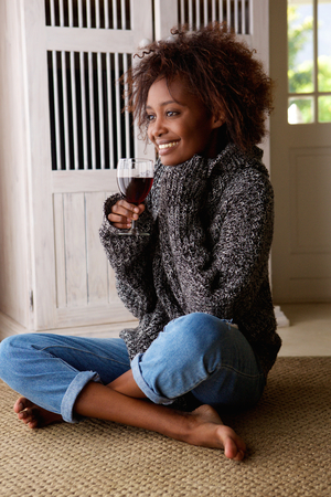 Portrait of a young african american woman enjoying a glass of wine