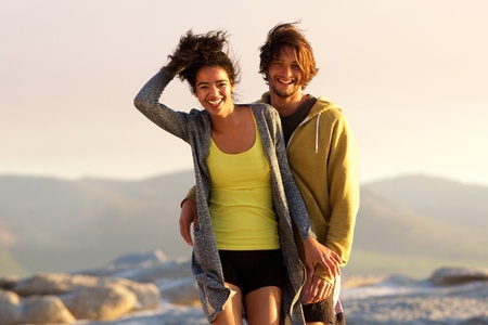 couple laughing: Portrait of a handsome young man and smiling woman outdoors Stock Photo