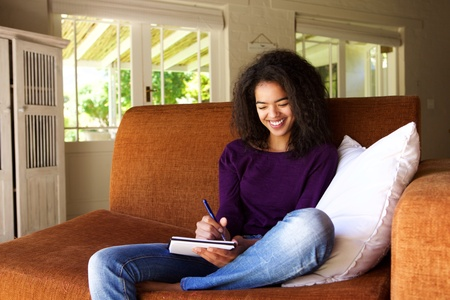writing book: Portrait of a beautiful young woman writing ideas in book