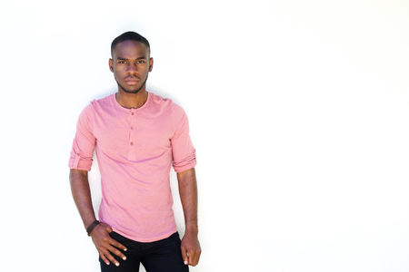 Portrait of serious young african man standing against white background Stock fotó