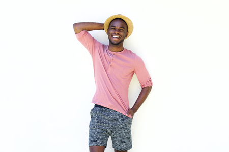 summer wear: Portrait of happy young african man in summer wear standing against white background