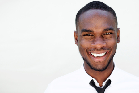 black businessman: Close up portrait of smiling handsome young african man on white background Stock Photo