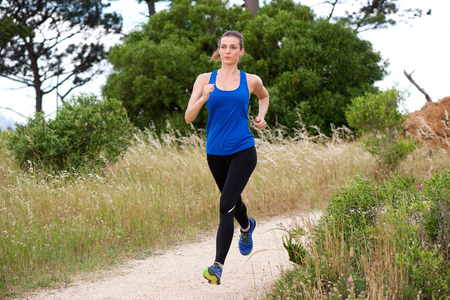 Full length portrait of older woman jogging in countryside Stock Photo - 57021136