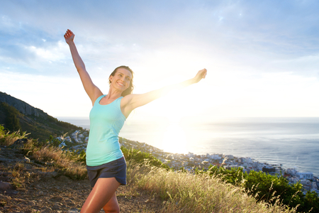 happy woman: Portrait of smiling athletic woman with arms outstretched Stock Photo