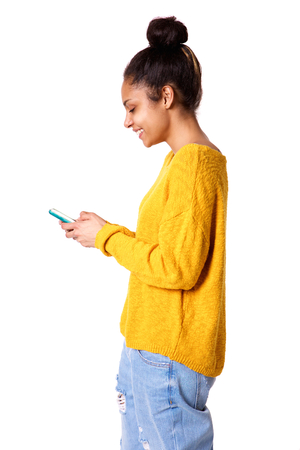 phone isolated: Profile portrait of happy young african woman with using mobile phone on white background