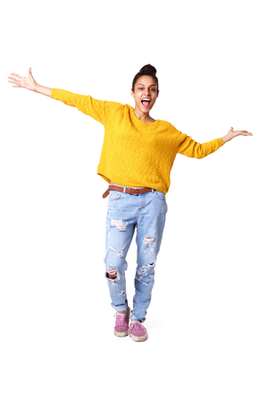 Full body portrait of excited young african woman standing with hers arms outstretched on white background Foto de archivo