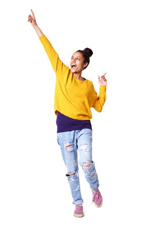 arms up: Full length portrait of excited young woman standing with her arms up on white background Stock Photo