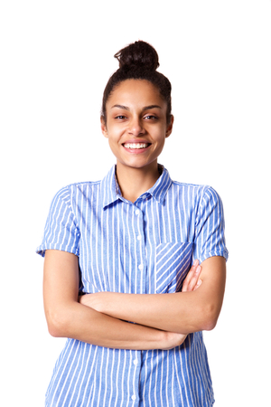 Portrait of smiling young lady standing with her arms crossed against white background Stock Photo