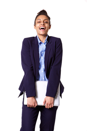 woman business suit: Portrait of young business woman smiling and holding laptop against white background Stock Photo