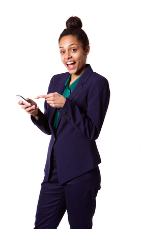 woman pointing: Portrait of smiling young african business woman pointing at her mobile phone against white background