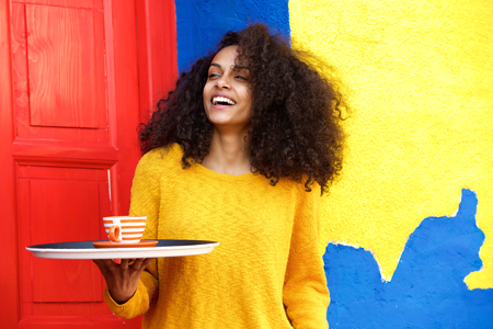 food tray: Portrait of cheerful female waitress with tray in a coffeeshop Stock Photo