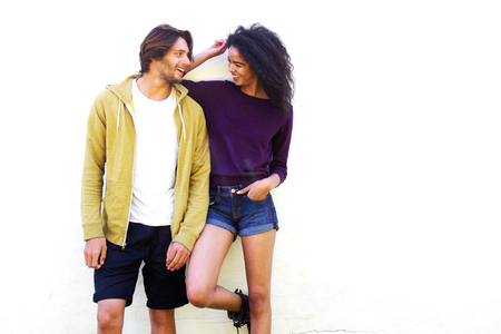 male models: Portrait of boyfriend and girlfriend smiling at each other Stock Photo