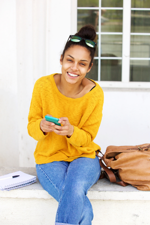 lady on phone: Portrait of attractive young lady sitting outside with mobile phone