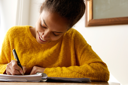 Woman writing stock photos royalty free woman writing images portrait of a young african american woman writing in book publicscrutiny Gallery