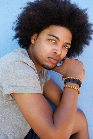 cool guy: Close up portrait of a cool guy with afro staring