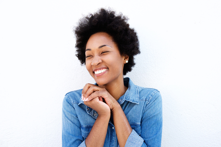 black hands: Portrait of delighted woman smiling by white wall
