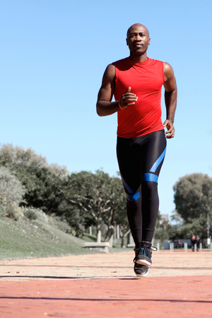 aged: Full length portrait of confident young african sports man running at the park
